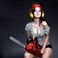 Sexy Girl holding a chainsaw stock photo