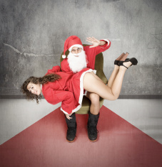 master santa claus with slave stock photo