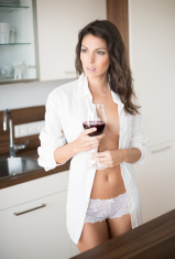 Beautiful Woman enjoying a Glas of Wine in Lingerie stock photo