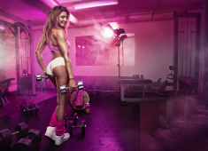 Nice sexy woman in gym, retouched stock photo
